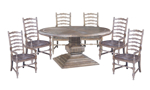 Big Sky dining set includes pedestal table and 6 armchairs.