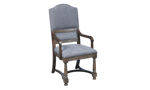 Neutral grey upholstered dining chair with arm rests and nail head trim.