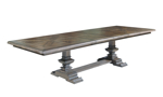 Expandable pedestal table with a hand-rubbed wood finish.