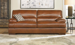 Classic and contemporary brown 90-inch top-grain leather sofa with 41-inch deep cushions in living room setting
