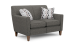 Contemporary loveseat in gray upholstered fabric with two throw pillows