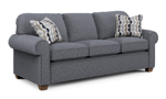 Thornton couch in a grey fabric with two throw pillows.