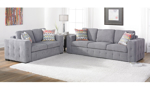 Room shot of the Rowan Grey fabric sofa and matching sleeper loveseat with tufted tailoring.