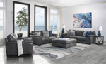 Room scene of the Medici Grey Leather 4-Piece Living Room Set including a sofa, loveseat, chair and ottoman in luxe grey top grain Italian leather.
