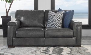 """71"""" wide grey leather loveseat that was handcrafted in Italy."""