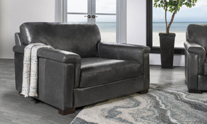 """56"""" wide grey leather accent chair."""