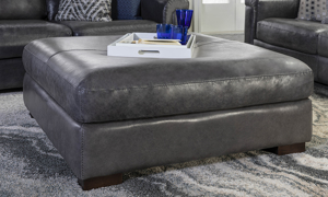 """44"""" wide square grey leather ottoman."""