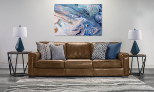 98-Inch wide brown leather couch that was handcrafted in Italy.
