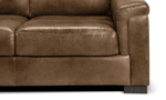 Detail shot of the leg and cushions of the Medici Chestnut Leather Sofa showing the high-end tailoring, unique layover armrests and luxe brown leather upholstery.