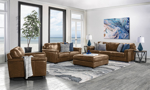 Room scene of the Medici Chestnut Leather 4-Piece Living Room Set including a sofa, loveseat, chair and ottoman in luxe brown top grain Italian leather.