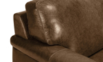 Close up shot of the Medici Chestnut Brown Leather Loveseat illustrating the premium craftsmanship, low-slung profile and backrest, and decorative stitching details.