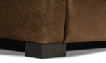 Detail shot of the Medici Chestnut Leather Seating Collection solid wood feet and Italian top grain leather finished with decorative stitching accents.