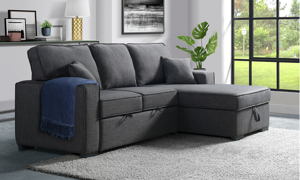 Grey living room sofa with chaise that turns into a sleeper.