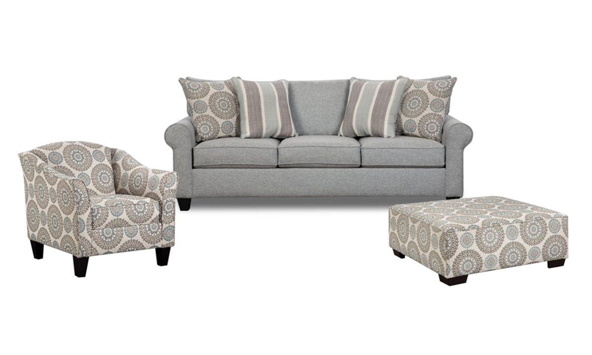 Claiborne living room set includes sofa, chair and ottoman.