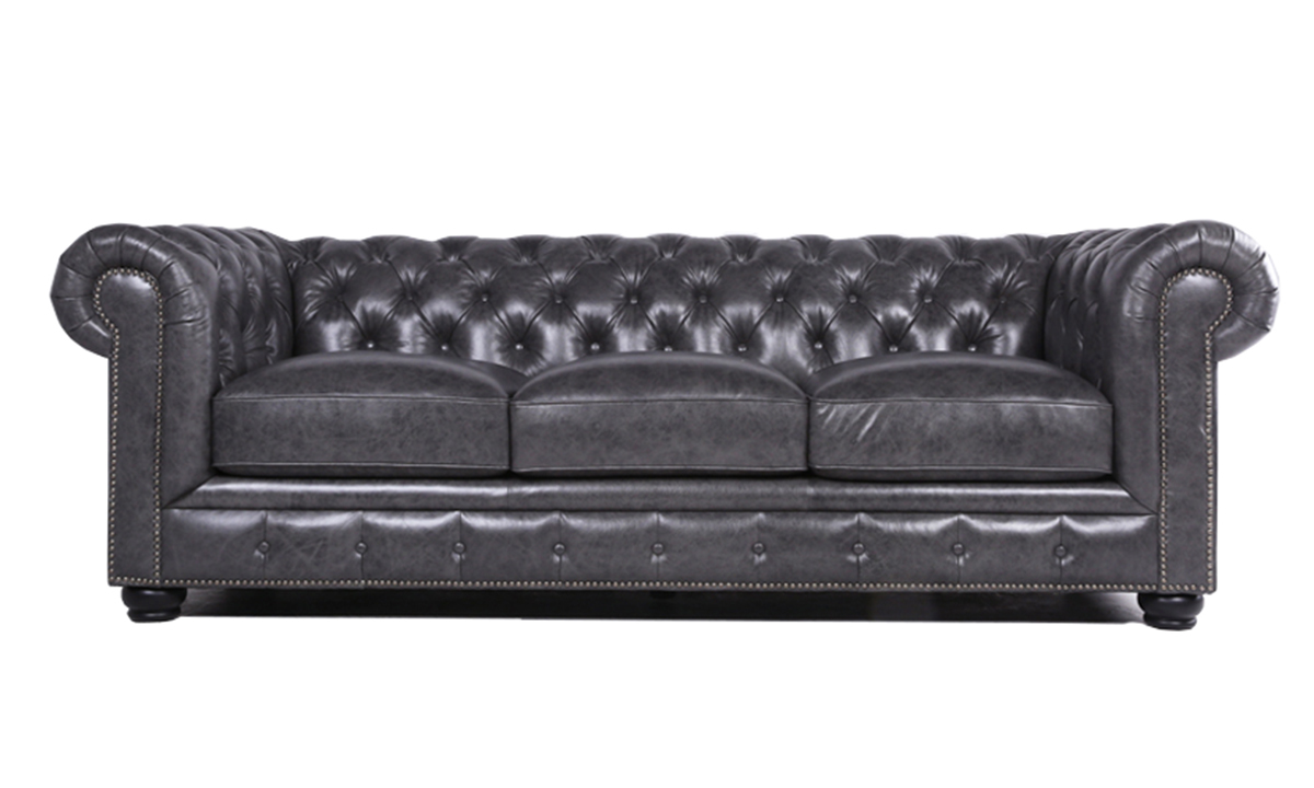 """95"""" wide classic chesterfield sofa with button tufting and nail head trim in a grey leather."""