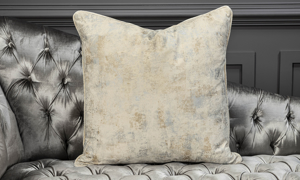 Throw pillow in an abstract cream and silver from Old Hickory Tannery