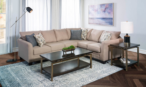 Neutral tan sectional that includes 5 accent pillows.