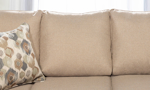 Tan polyester back cushions on the London sectional from J Furniture.