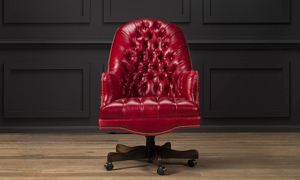 Red leather office chair that was made in America.