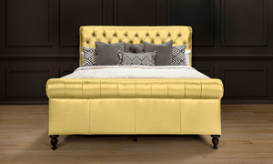 Soft yellow top grain leather sleigh bed.