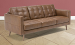 Tufted sofa made from Italian top grain leather in a living room.