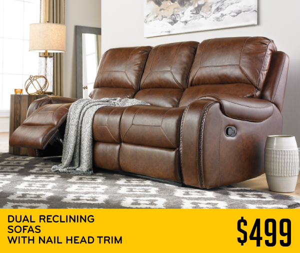 Dual Reclining Sofas With nail head trim 499