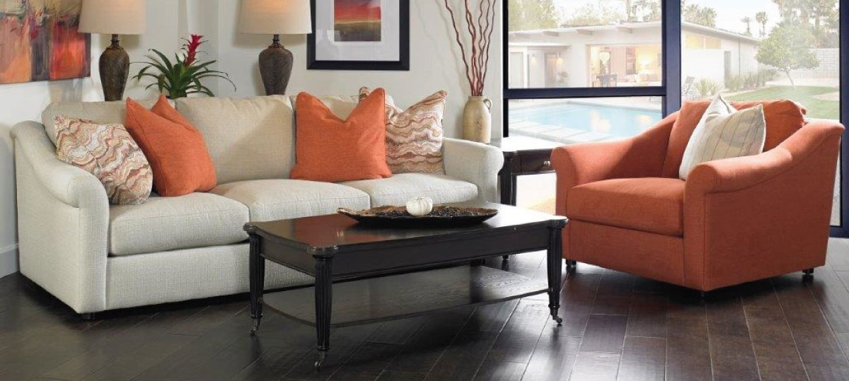 Orange Chair and White Sofa with Orange Accent Pillows